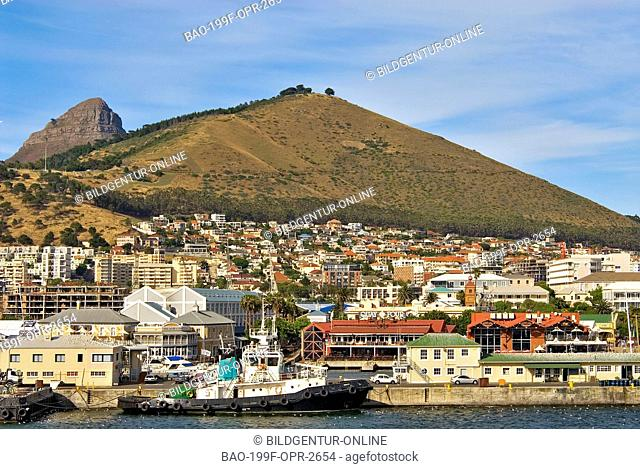 This stock photo shows the harbour of Cape Town in South Africa from seaside with the Signal Mountain in the background