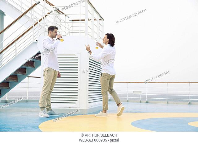 Two young men drinking beer on cruise ship