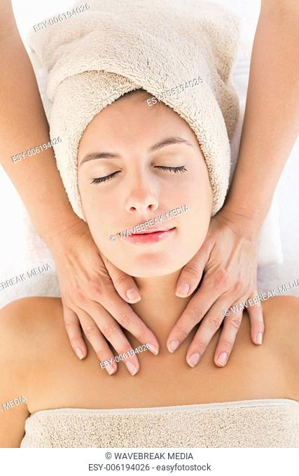 Attractive young woman receiving massage at spa center