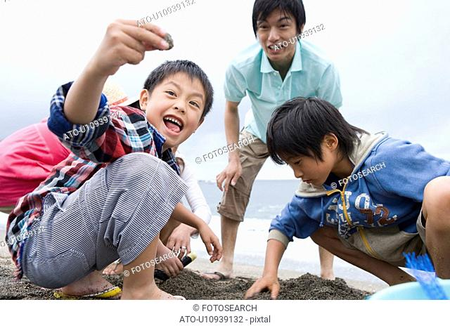 Family collecting seashells
