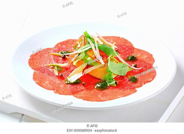 Beef Carpaccio with pesto sauce and Parmesan