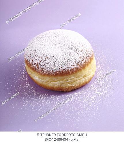 A carnival doughnut with icing sugar