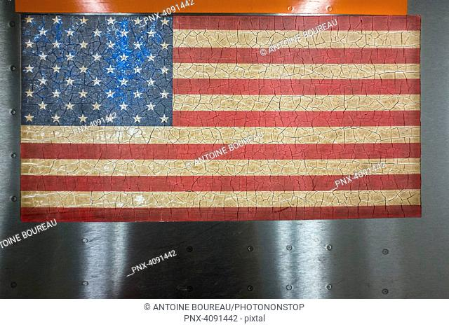 American flag cracked on a subway train in New York, USA