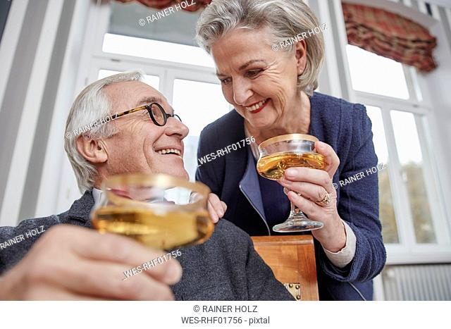 Happy senior couple drinking champagne