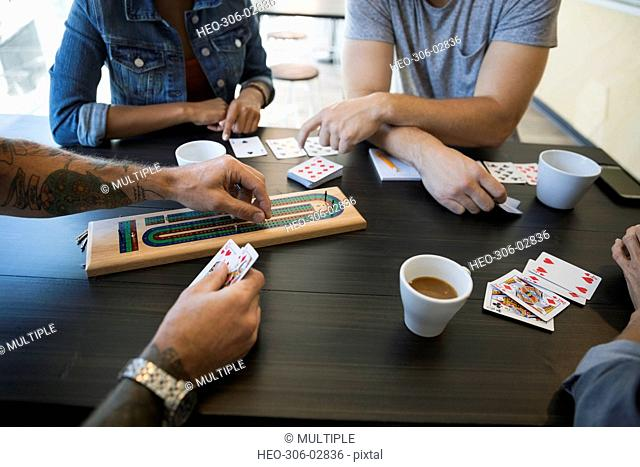 Friends playing cribbage game at cafe