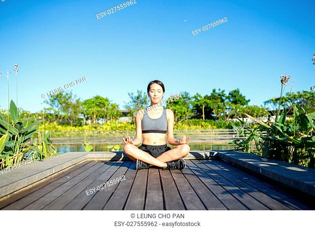 Woman sitting in yoga pose