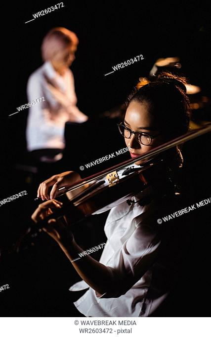 Female student playing violin