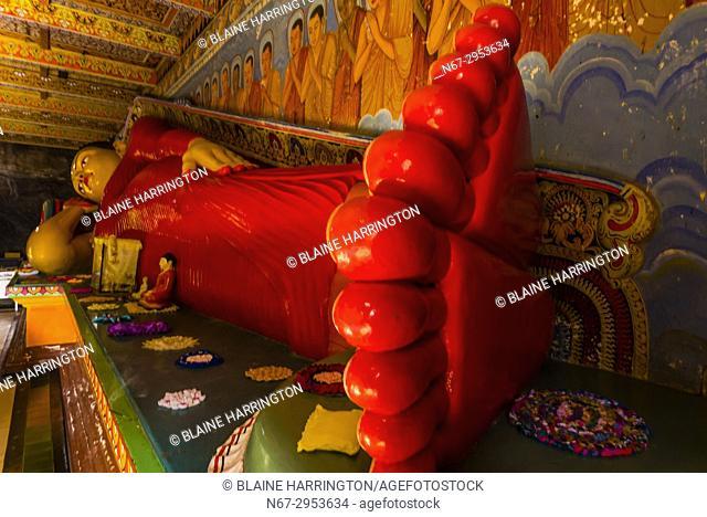 Reclining Buddha, Isurumuniya Temple, Anuradhapura, Sri Lanka. Anuradhapura is one of the ancient capitals of Sri Lanka, famous for its well-preserved ruins of...