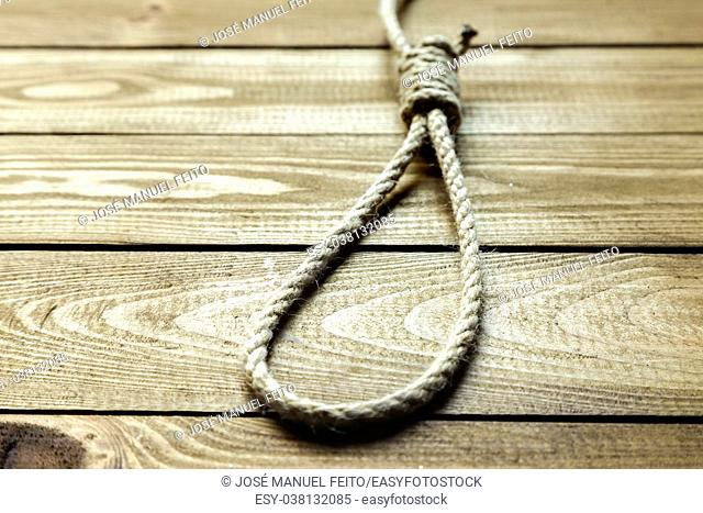 sliding knot on wooden background