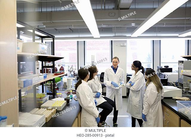 Scientist leading meeting in laboratory