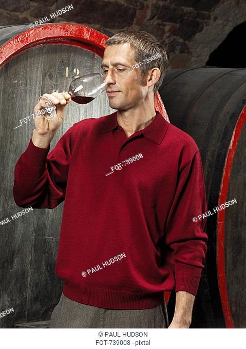 A vintner tasting a red wine