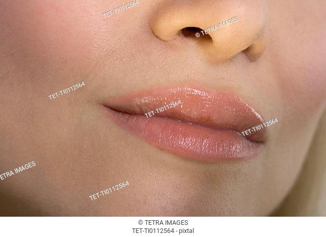 Closeup of woman's lips and nose