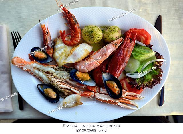 Typical fish dish with shrimps, mussels, whiting, octopus, boiled potatoes, Lanzarote, Canary Islands, Spain