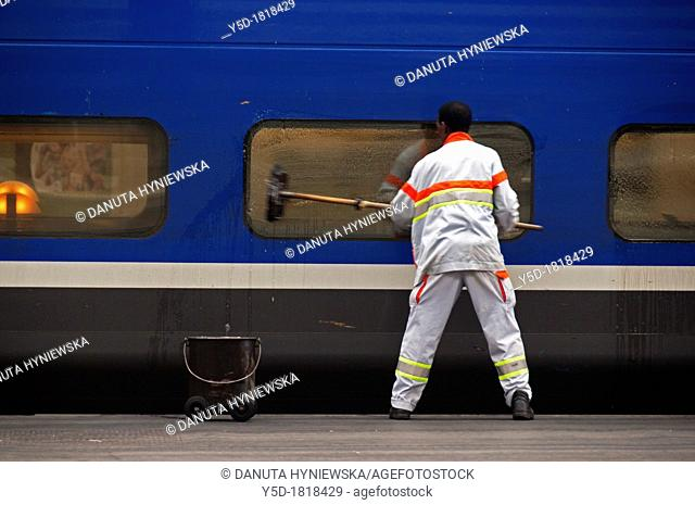 cleaning of train windows in Gare Lyon main railway station, Paris, France
