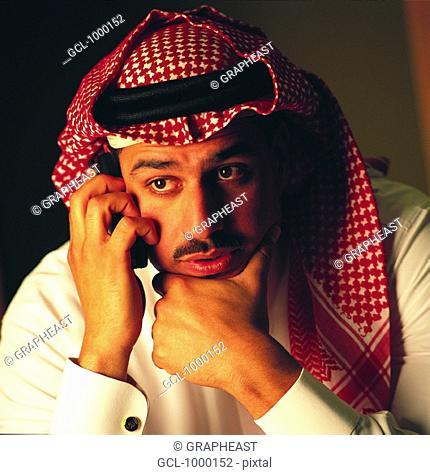 Arab man using mobile phone