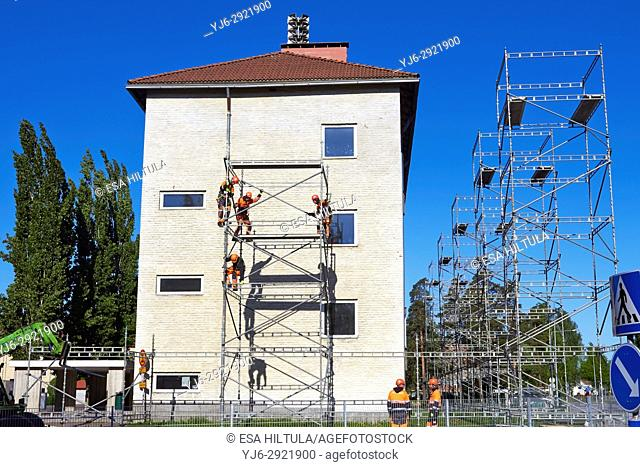 Men building scaffolding, Finland