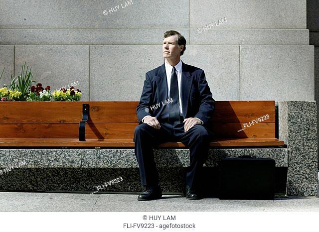 Businessman on Bench, Toronto, Ontario