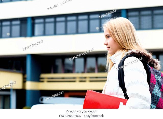 nice blond girl in front of school building
