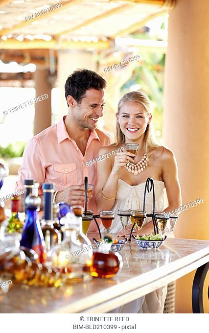 Couple drinking together in bar