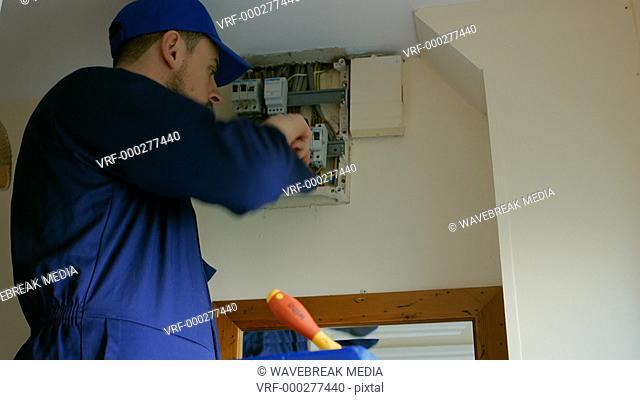Man fixing the fusebox