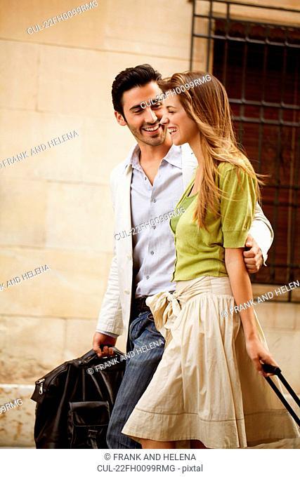 Couple walking with luggage