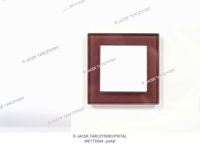 light switch with glass frame on the wall