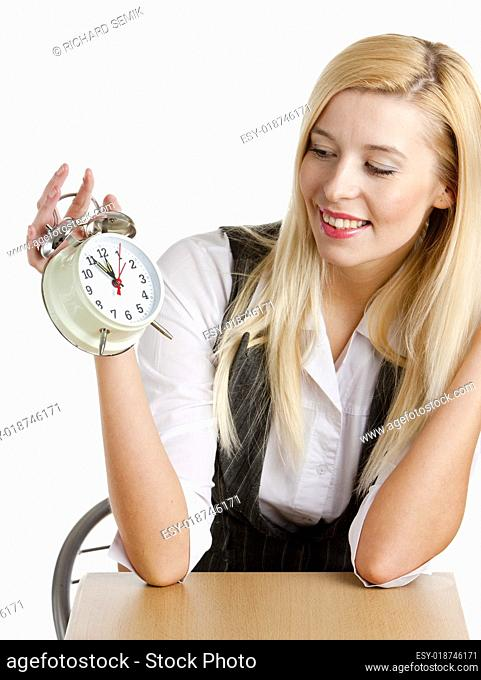 portrait of businesswoman with an alarm clock