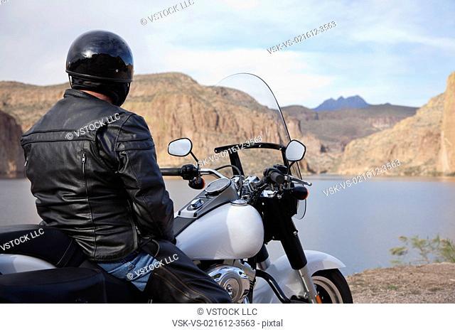 USA, Arizona, Phoenix, Biker on motorcycle in mountain area