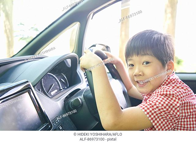 Japanese kid in the car