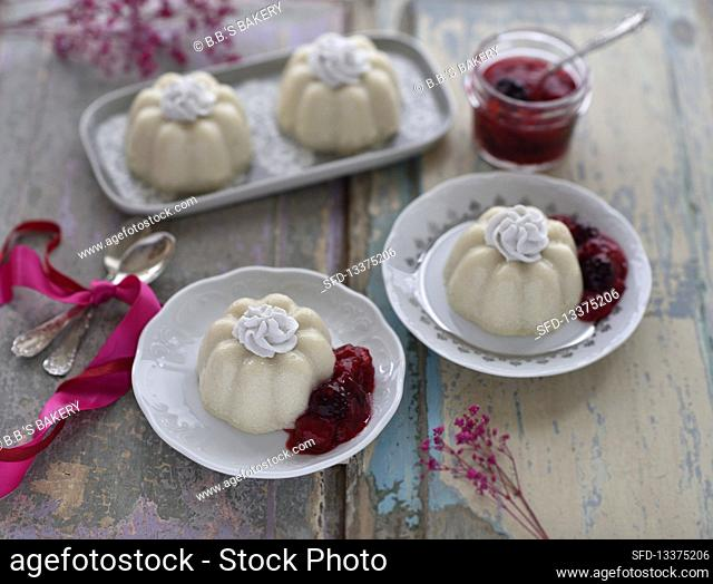 Vegan white polenta puddings with berry compote