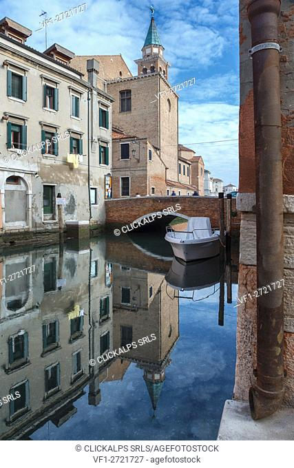 Europe, Italy, Veneto, Chioggia. Buildings reflecting on the Canal Vena