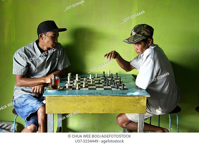 Playing chess in Selakau coffee shop, West Kalimantan, Indonesia