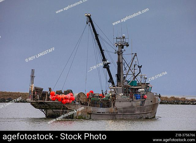 Commercial fishing vessel Pacific Viking heading out from Steveston Harbour to lay Crab Pots British Columbia Canada