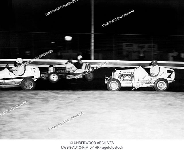 New York, New York: c. 1940 Wes Saegesser (#7), the one armed race car driver whose left arm ended at the elbow, racing midget cars at Castle Hill Speedway in...