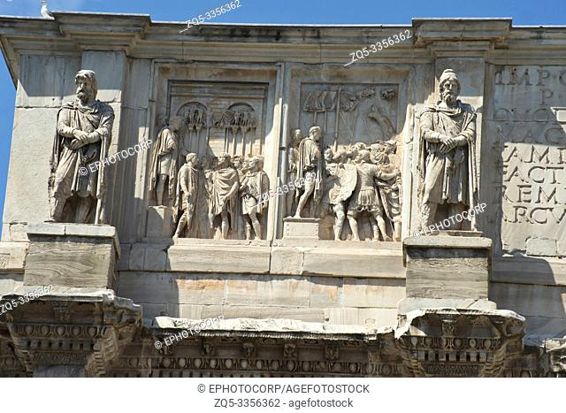 Roman figures on the three arched gate, Colosseum, famous amphitheater, Rome