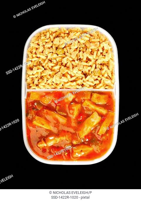 Plastic tray with sliced chicken and white rice