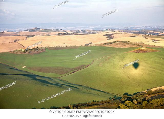 Balloon shadow on farmlands. Tuscany, Italy