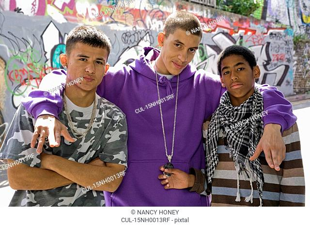 Teenage gang against graffiti wall