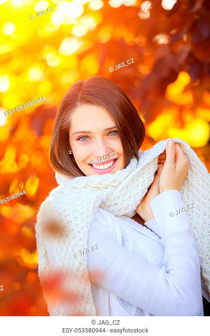 Beautiful young woman autumn portrait with scarf. Beauty and fashion photo, seasonal and holiday