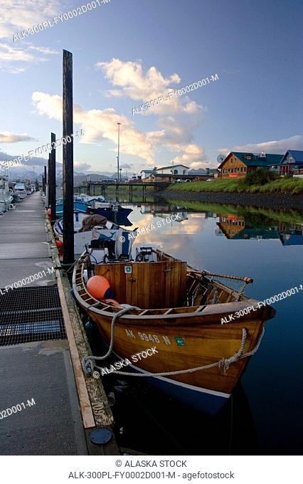 Classic wooden fishing boat in boat harbor Homer Spit early morning Kenai Peninsula Alaska Summer