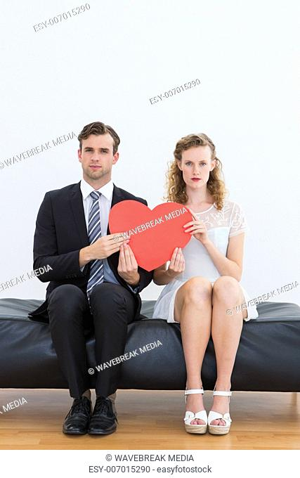 Geeky couple sitting on couch