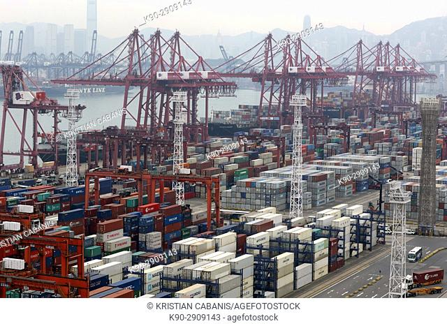 Stacks of container and loading bridges at the contrainer terminal of Hong Kong's harbor, Hong Kong, China, East Asia