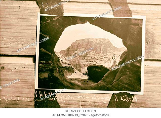 Petra, Wadi Musa, El-M'esrah area. Umm el Biyara and el Habis. Taken through the opening of a cave. 1920, Jordan, Petra (Extinct city)