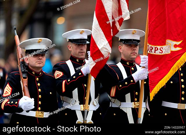 Holland, Michigan, USA - May 11, 2019: Tulip Time Parade, Members of the United States Marine Corps scorting the American Flag during the parade