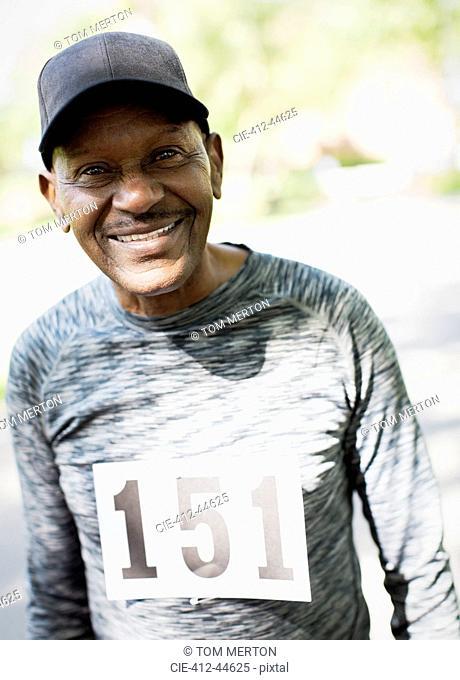 Portrait smiling, confident active senior man wearing sports race bib