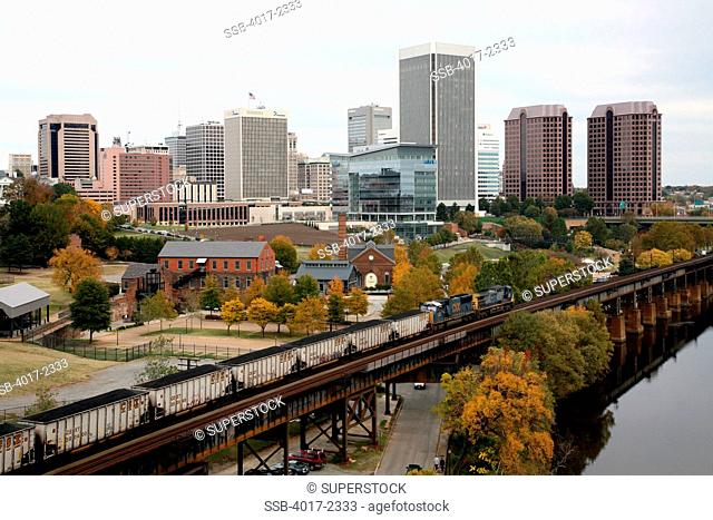 Skyline of Richmond, Virginia with freight train and The American Civil War Center at Historic Tredegar in Foreground