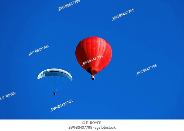red hot air ballon and paraglider over lake Annecy, France, Savoie, Haute Savoie, Annecy