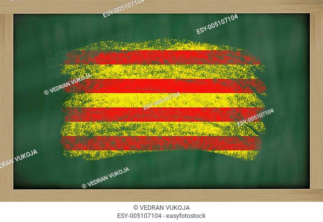 flag of catalonia on blackboard painted with chalk