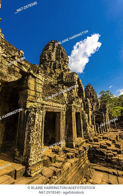 The Bayon (Angkor Thom), Shaped like a pyramid, this symbolic temple-mountain features 54 towers, bearing more than 200 serene and smiling stone faces; Angkor...