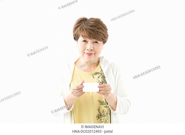 Senior woman showing ID